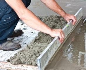 Man Smoothing Concrete